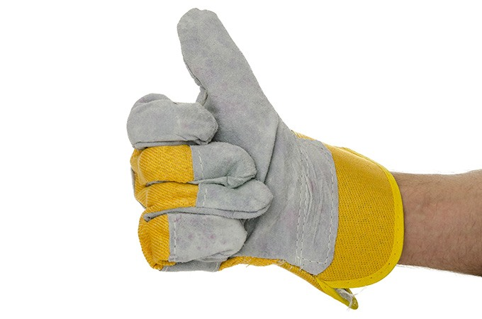Hands in safety gloves