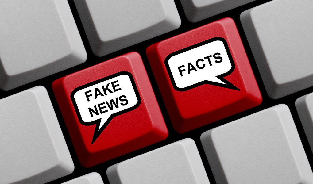 """Up close graphic of keys on keyboard with one that says 'Fake News'""""' and another that says 'Facts.'"""