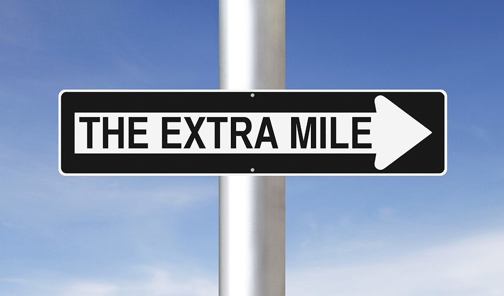 The Extra Mile sign